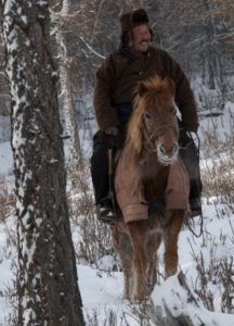 "A Winter Afternoon in the Darkhid Valley. Herder Yadmaa and his Horse on ""patrol""."