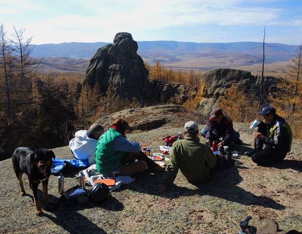 a group of riders with Stone Horse Expeditions enjoying lunch, sunshine and spectacular scenery in Gorkhi Terelj National Park, Mongolia