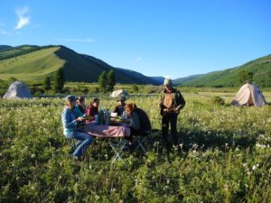 Horse Trek Camping in Mongolia, Dining outside on a summer evening in Gorkhi Terelj National Park, Stone Horse Expeditions & Travel Mongolia