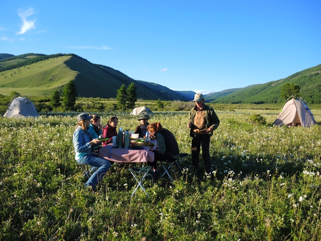 Horse Trek Camping in Mongolia, Dining outside on a summer evening in Gorkhi Terelj National Park, Stone Horse Expeditions & Travel