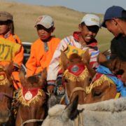 Young riders on their winning horses after the race