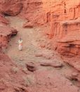 Local guide in red canyon landscape in Mongolia's Gobi desert